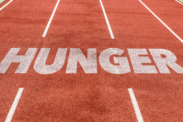 Hunger written on running track