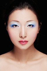 Colorful makeup on Asian model face. Woman makeup cosmetic image.