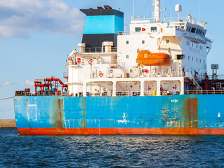 A lifeboat on the rear of a cargo ship.