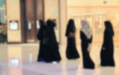 Arab woman walking through the mall,