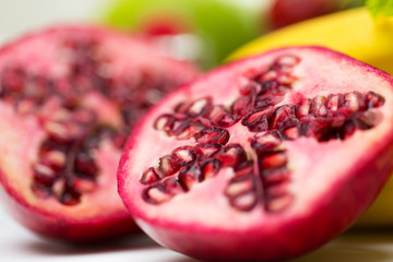 close up of ripe pomegranate and other fruits