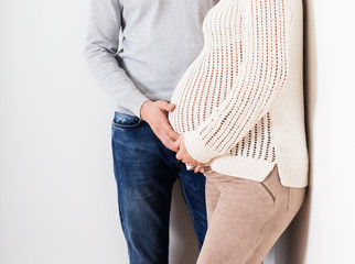 Pregnant couple on white background