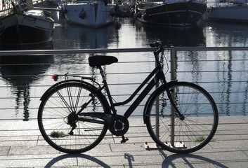 Bicycle on the pier in backlight
