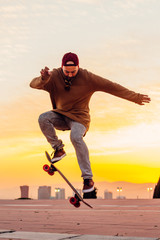 Skater Jumping at Sunset