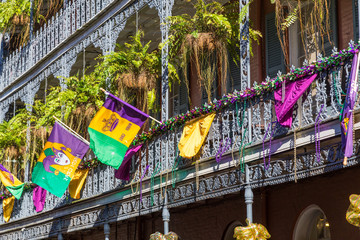 Ironwork galleries on the Streets of French Quarter decorated for Mardi Gras in New Orleans,  Louisiana Fotomurales