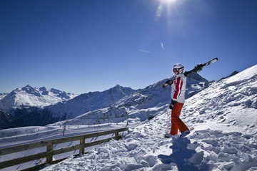 Young woman enjoying skiing in Solden, Austria