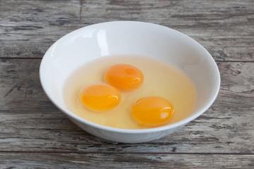 Three raw egg yolk on the plate