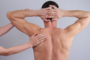 Chiropractic, osteopathy, pain relief concept. Dorsal manipulation therapist  doing healing treatment on man back