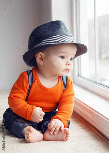 c3bb42e0c9e Portrait of cute adorable stylish Caucasian baby boy with black eyes in hat