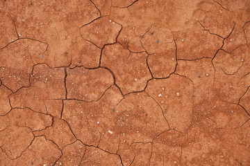 Cracked red clay soil Fototapete