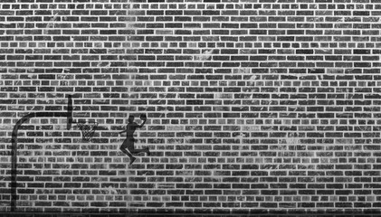 Guy Slam dunking a basketball - Silhouette of a guy dunking a basketball in front of brick wall in blacking and white