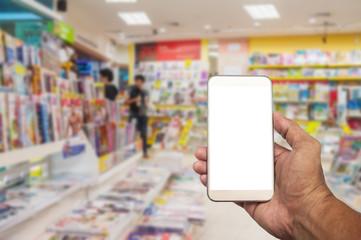The men using smartphone in book shop