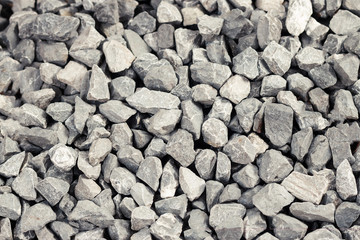 Background of gray granite gravel texture closeup details.