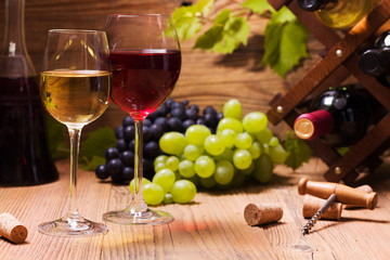 Glasses of red and white wine, served with grapes