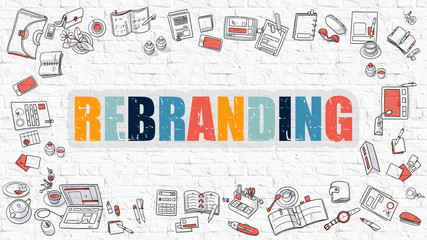 Rebranding. Multicolor Inscription on White Brick Wall with Doodle Icons Around. Rebranding Concept. Modern Style Illustration with Doodle Design Icons. Rebranding on White Brickwall Background.