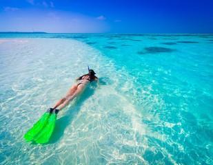 Maldives,  woman snorkeling!