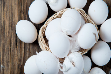 White Eggs on Wooden Background