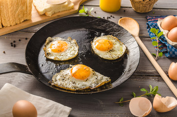 Foto auf Acrylglas Eier Eggs fried rustic style