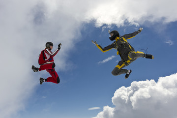 Two parachutists girls in free fall.