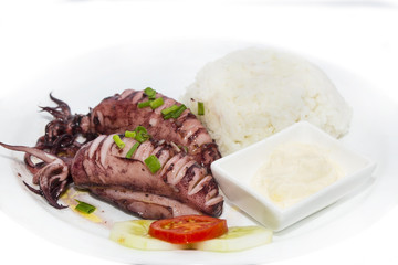 with rice and salad and sauce grilled squid