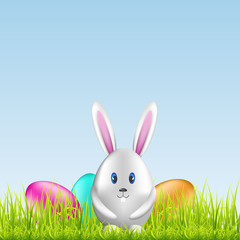 Easter bunny and colorful eggs on spring medow