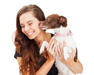Small Dog Kissing Beautiful Young Woman
