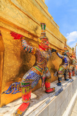 The characters in literature Thailand carrying giant golden pagoda of Wat Phra Kaew , also known as the Emerald Buddha Temple in Bangkok .