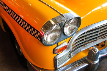 Yellow Cab Taxi, Color detail on the headlight of Taxi Checker
