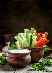 Fresh sticks carrots, celery, cucumber and white sauce with herb