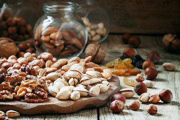Nuts set of pistachios, walnuts, almonds and hazelnuts on a wood