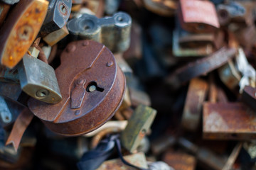 Many of the old, rusty locks, linked together