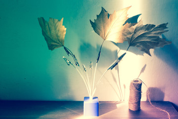 a vintage photo holder with leaves on it, abstract concept