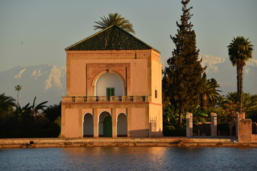 Menara park, Marrakech, Morocco,Africa.  The public park pavilion over looking the man made lake fed from the Atlas Mountains in the background.