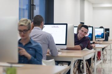 startup business, software developer working on desktop computer