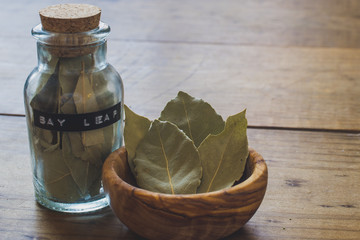 Bay Leaves in Wooden Bowl and Spice Jar