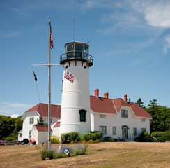 Chatham Lighthouse stands in the brilliant sunlight in Chatham, Massachusetts.