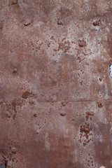 remnants of the old red paint on a piece of wall