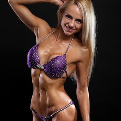 Sexy bodybuilder woman in black bikin