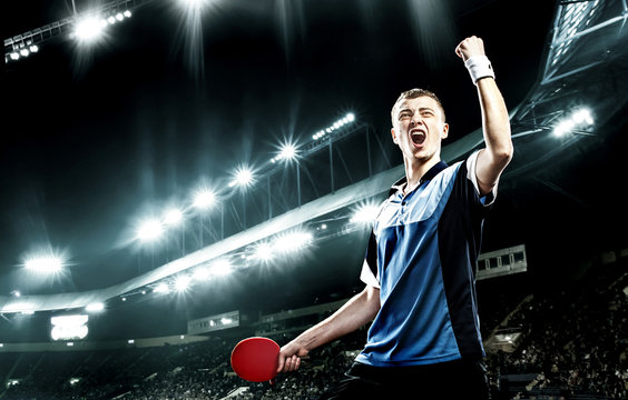 Young handsome sportsman celebrating flawless victory in table tennis