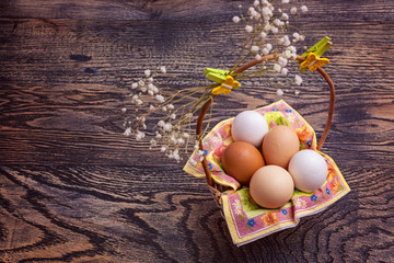 Eggs in a basket on the wood texture