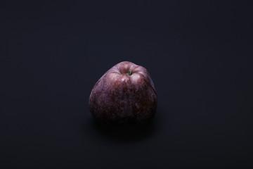 red apple against black background