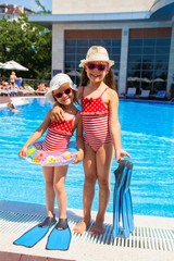 little girlfriends at  swimming pool