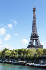 Eiffel Tower vertical landscape, river seine and boats, copy space