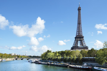 Eiffel Tower distant horizontal landscape, river seine and boats