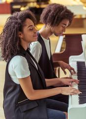 Couple playing piano