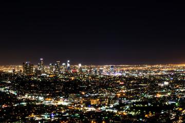Fotobehang Los Angeles Long exposure night view of Los Angeles downtown and surrounding metropolitan area