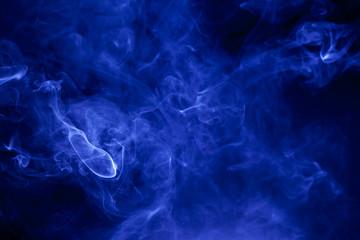Blue smoke on a black background.