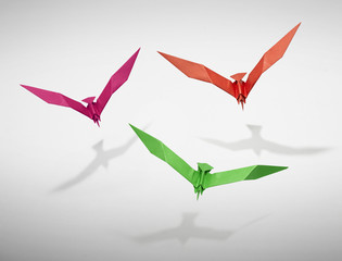 Group of three flying birds in Origami- clipping path