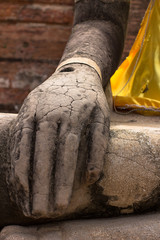 Lord Buddha placing hands on the laps, is respectfully engaged placed at an ancient temple that was built over 600 years ago in Thailand's ancient capital of Ayutthaya.