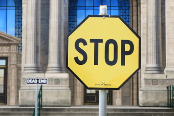 Yellow stop sign. Signs and symbols